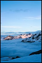 Snowy mountains and see of clouds at sunset. Kenai Fjords National Park ( color)