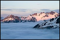 Midnight sunset on peaks above clouds. Kenai Fjords National Park ( color)