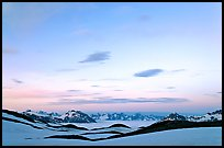 Pastel sky, mountain ranges and sea of clouds at dusk. Kenai Fjords National Park ( color)