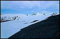 Rocky slope and snow-covered Harding Icefield at dusk. Kenai Fjords National Park ( color)