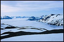 Dark bands of freshly uncovered terrain, snow, and low clouds, dusk. Kenai Fjords National Park ( color)