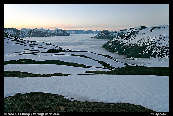 Bands freshly uncovered by snow, and low clouds, sunrise. Kenai Fjords National Park (color)