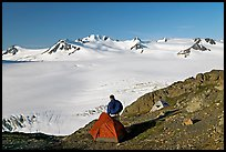 Tent and backpacker above the Harding icefield. Kenai Fjords National Park ( color)