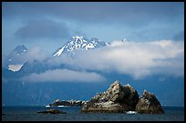 Rocky islets and cloud-shrouded peaks, Aialik Bay. Kenai Fjords National Park, Alaska, USA.