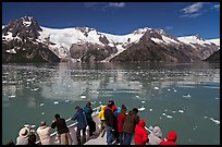 People looking at glaciers as boat crosses ice-chocked waters, Northwestern Fjord. Kenai Fjords National Park ( color)