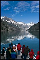 Mountains reflected in fjord, seen by tour boat passengers, Northwestern Fjord. Kenai Fjords National Park, Alaska, USA.