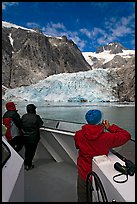 Passengers looking at Northwestern glacier from the deck of tour boat. Kenai Fjords National Park, Alaska, USA.