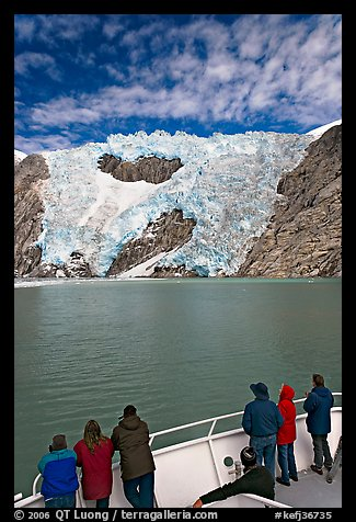 People watch  Northwestern glacier from deck of boat, Northwestern Lagoon. Kenai Fjords National Park (color)