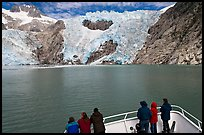 People looking at Northwestern glacier from deck of boat, Northwestern Fjord. Kenai Fjords National Park, Alaska, USA.