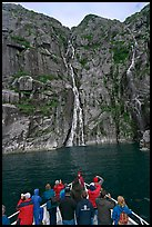 Passengers looking at waterfalls from  bow of tour boat, Cataract Cove. Kenai Fjords National Park ( color)