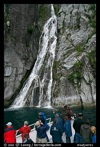 Passengers look at waterfall from tour boat, Cataract Cove, Northwestern Fjord. Kenai Fjords National Park (color)