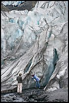 Couple checking out the ice at the terminus of Exit Glacier. Kenai Fjords National Park, Alaska, USA.