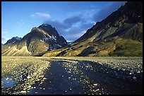 Wide gravel river bar below the Telaquana Mountains, sunset. Lake Clark National Park ( color)