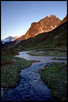 Stream on plain  below the Telaquana Mountains, late afternoon. Lake Clark National Park ( color)