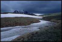 Snow nevesand mountains under dark storm clouds. Lake Clark National Park ( color)
