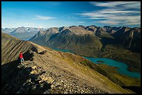 Visitor looking, summit of Tanalian Mountain and Kontrashibuna Lake. Lake Clark National Park ( color)