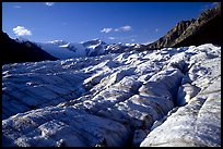Crevasses on Root glacier, Wrangell mountains in the background, late afternoon. Wrangell-St Elias National Park, Alaska, USA. (color)