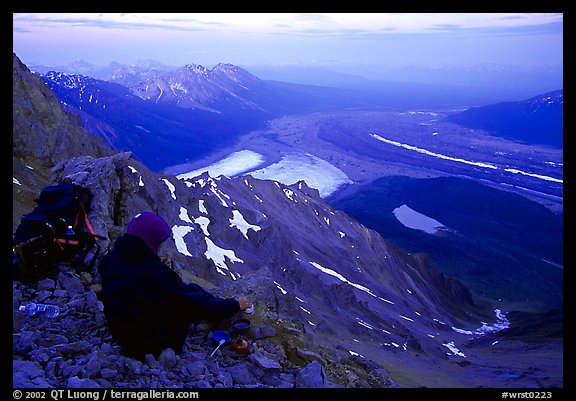 Mountaineer looking down from Mt Donoho. Wrangell-St Elias National Park, Alaska, USA.