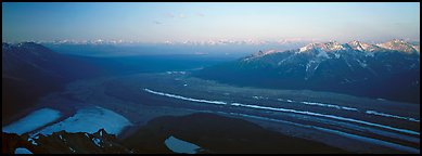 Elevated view of glacier terminal section and mountains. Wrangell-St Elias National Park (Panoramic color)