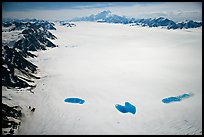 Aerial view of Bagley Field with turquoise snow melt lakes. Wrangell-St Elias National Park, Alaska, USA. (color)