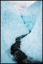 Glacial stream between steep walls of ice, Root Glacier. Wrangell-St Elias National Park ( color)