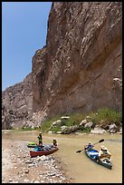 Canoeists bellow steep walls of Boquillas Canyon. Big Bend National Park, Texas, USA. (color)