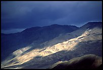 Storm light on foothills. Death Valley National Park, California, USA. (color)