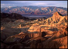 Badlands, Valley, and Telescope Peak from Zabriskie Point, winter sunrise. Death Valley National Park, California, USA. (color)