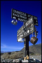 Tea kettle Junction sign, adorned with tea kettles. Death Valley National Park ( color)