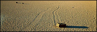 Moving stones on dried mud playa. Death Valley National Park (Panoramic color)