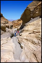 Hikers in narrows, Mosaic canyon. Death Valley National Park ( color)