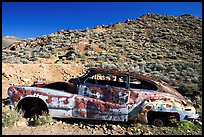 Car with bullet holes near Aguereberry camp, afternoon. Death Valley National Park, California, USA. (color)