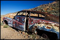 Car with bullet holes near Aguereberry camp, afternoon. Death Valley National Park ( color)