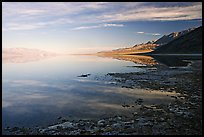 Flooded Badwater basin and Black mountain reflections, early morning. Death Valley National Park ( color)
