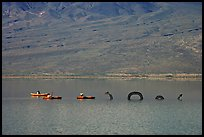 Kayakers approaching the dragon in the rare Manly Lake. Death Valley National Park ( color)