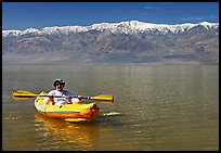 Kayaker padding ephemeral Manly Lake. Death Valley National Park ( color)