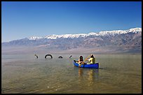 Canoe near the dragon in Manly Lake, below the Panamint Range. Death Valley National Park ( color)