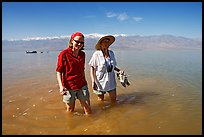Women wading in the knee-deep seasonal lake. Death Valley National Park ( color)