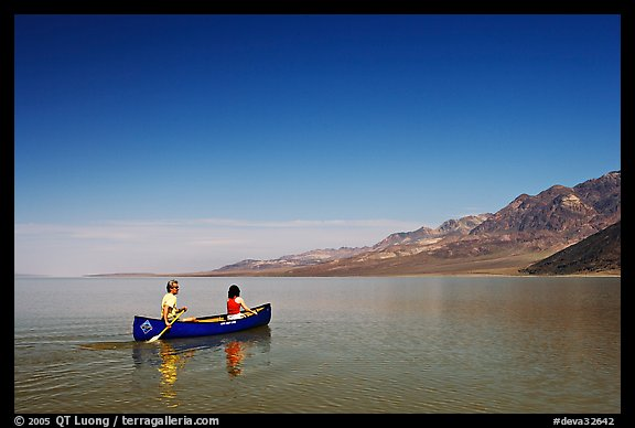 Canoeing on the ephemerald Manly Lake with Black Mountains in the background. Death Valley National Park (color)