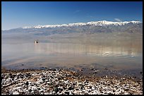 Salt formations, kayaker in a distance, and Panamint range. Death Valley National Park ( color)
