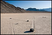 Moving rocks and non-linear tracks, the Racetrack. Death Valley National Park, California, USA. (color)