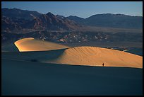 Hiker on ridge, Mesquite Dunes, sunrise. Death Valley National Park ( color)
