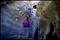 Hikers climbing in a narrow side canyon. Death Valley National Park ( color)