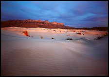 Gypsum dune field and last light on Guadalupe range. Guadalupe Mountains National Park, Texas, USA.
