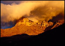 El Capitan and low clouds at sunrise. Guadalupe Mountains National Park ( color)