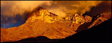 Cliffs and clouds illuminated by low sun. Guadalupe Mountains National Park (Panoramic color)