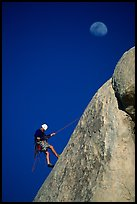 Climber rappelling down with moon. Joshua Tree National Park, California, USA. (color)