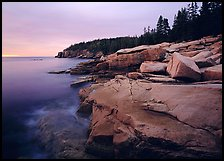 Coastline with granite slabs near Otter Point, sunrise. Acadia National Park, Maine, USA.