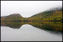 Hills, reflections, and fog in autumn, Jordan Pond. Acadia National Park, Maine, USA.