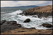 Wave, Schoodic Point, and Cadillac Mountain. Acadia National Park, Maine, USA.